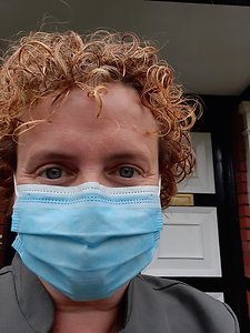 COVID-19 AND PATIENT SAFETY. Me standing outside front door with mask